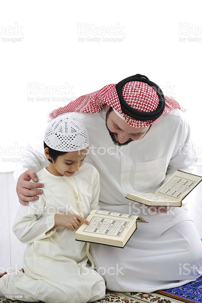 Father teaching little son stock photo