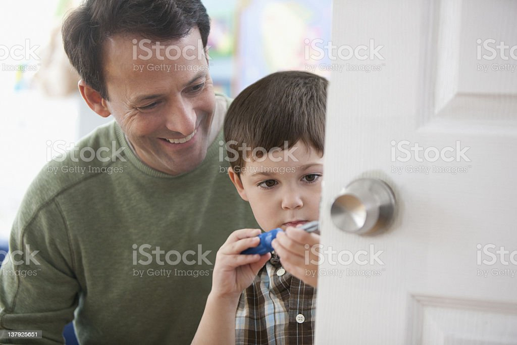 Father teaching son how to make home improvement stock photo