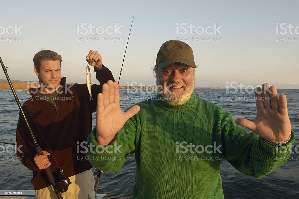 Father Telling Fish Story stock photo