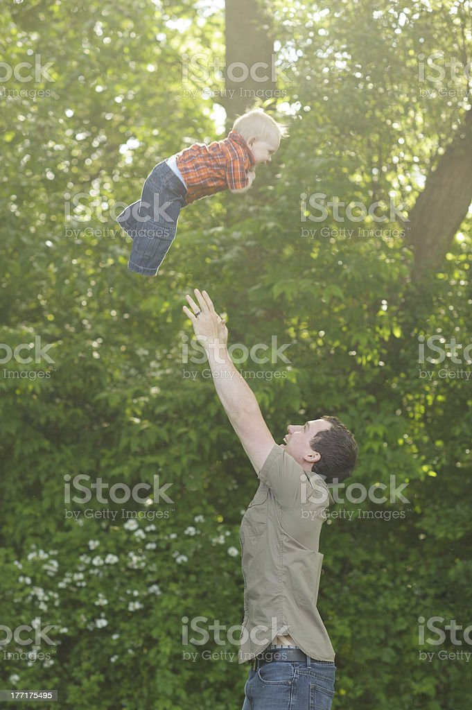 Father Throwing Son in Air royalty-free stock photo