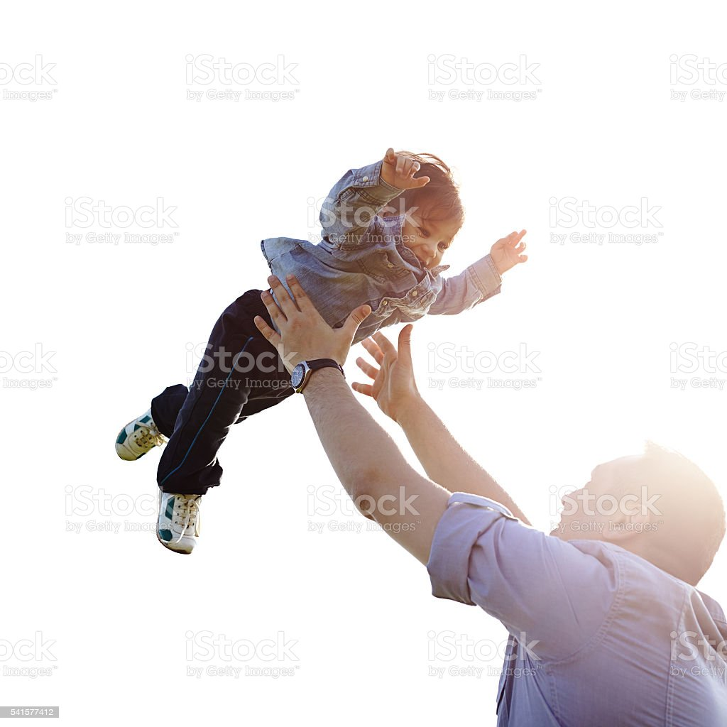 Father throwing son into air stock photo