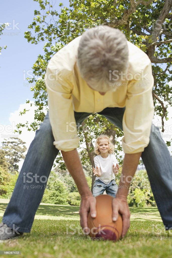 Father throws an american football to his son royalty-free stock photo