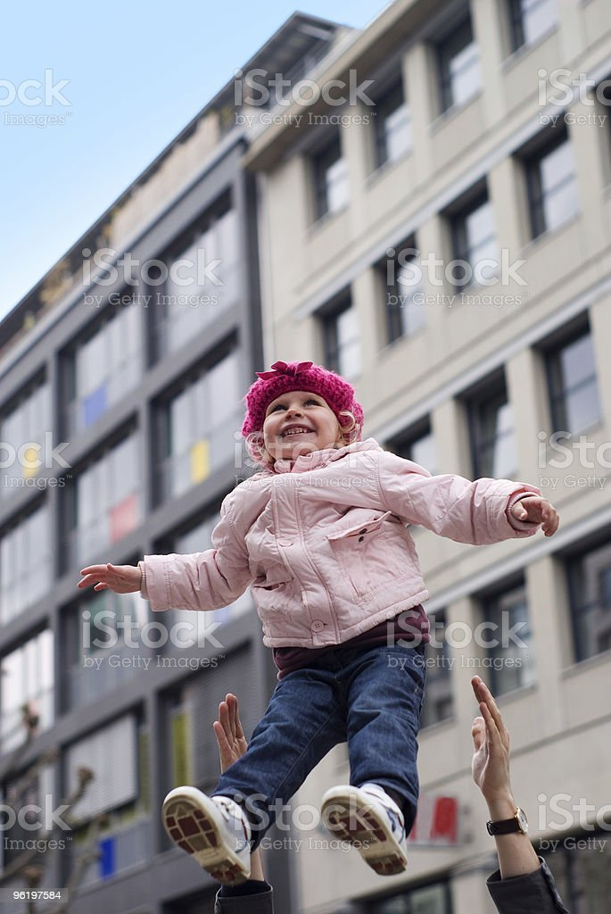 Father throws the daughter stock photo