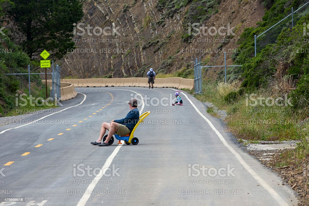 Father training his son to slide on an abandoned highway stock photo