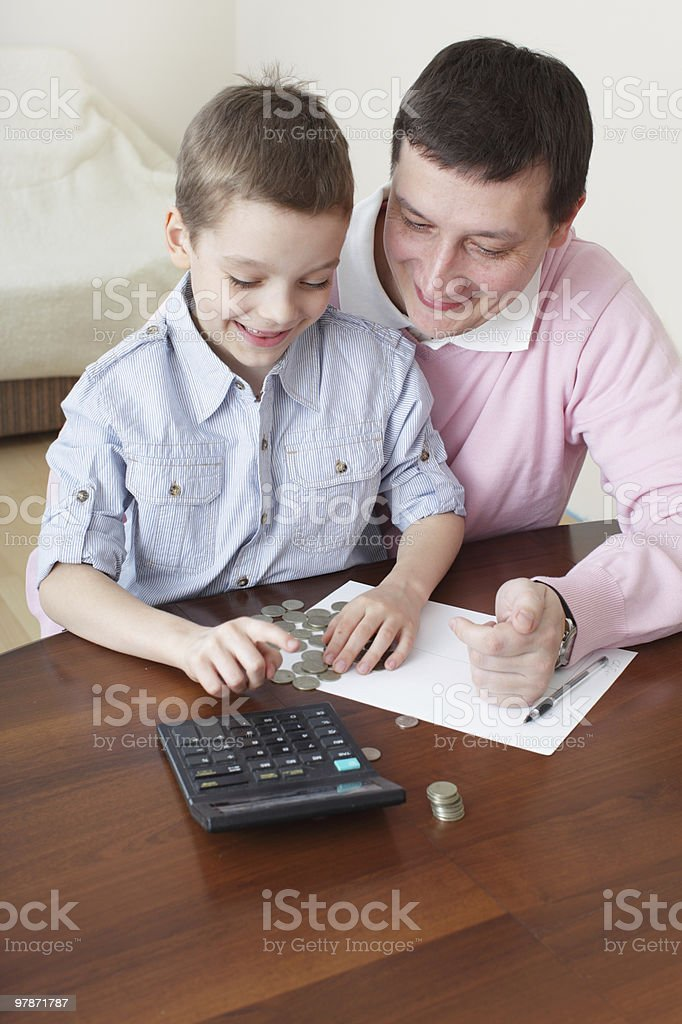 Father training son to the finance royalty-free stock photo
