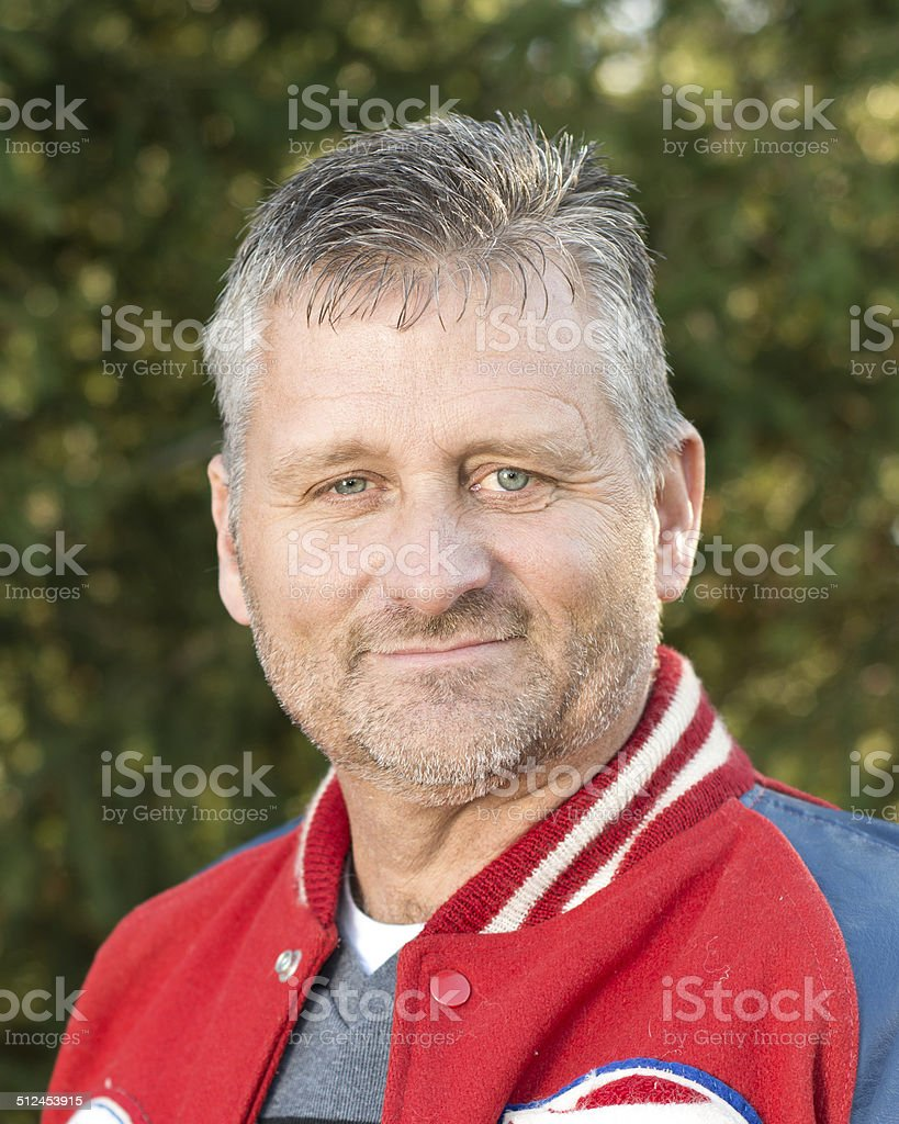 Father wearing Letterman Jacket stock photo