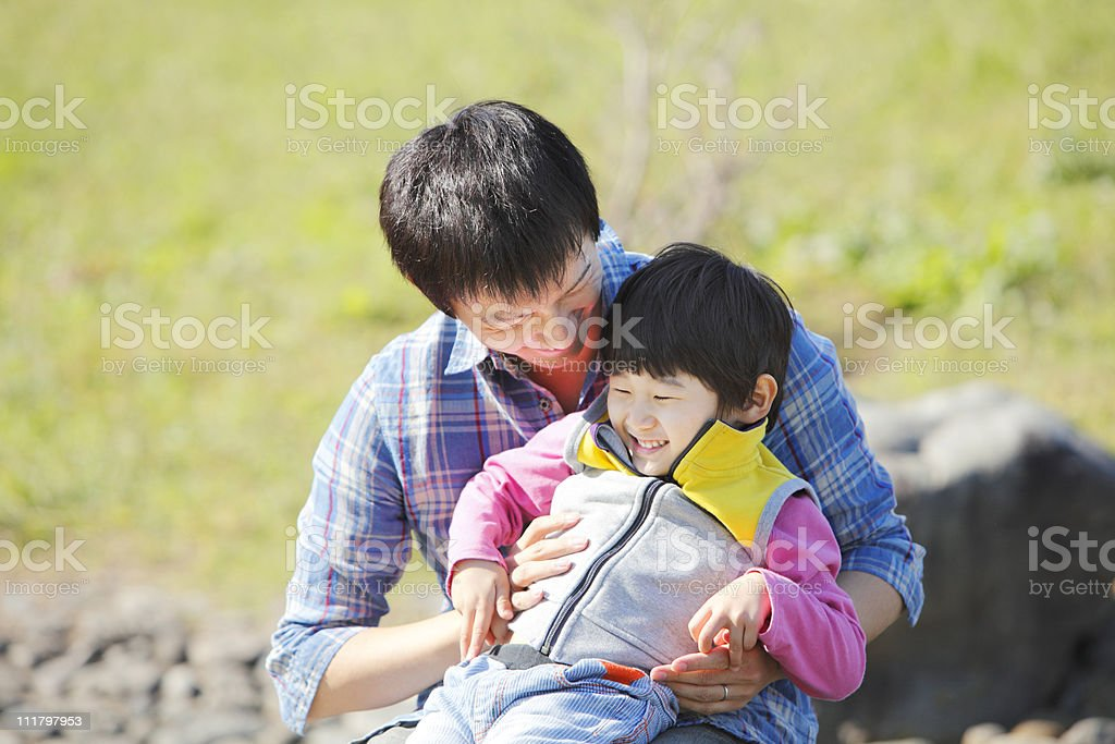 Father who watches child stock photo