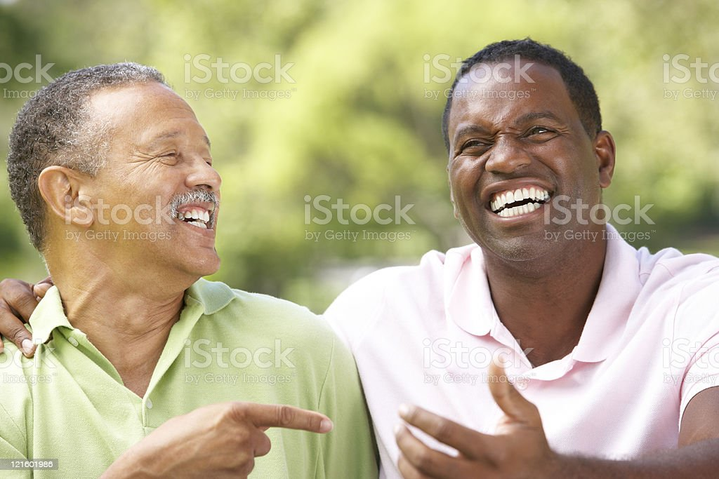 Father With Adult Son In Park stock photo