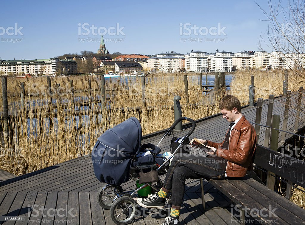 Father with babycarriage. stock photo