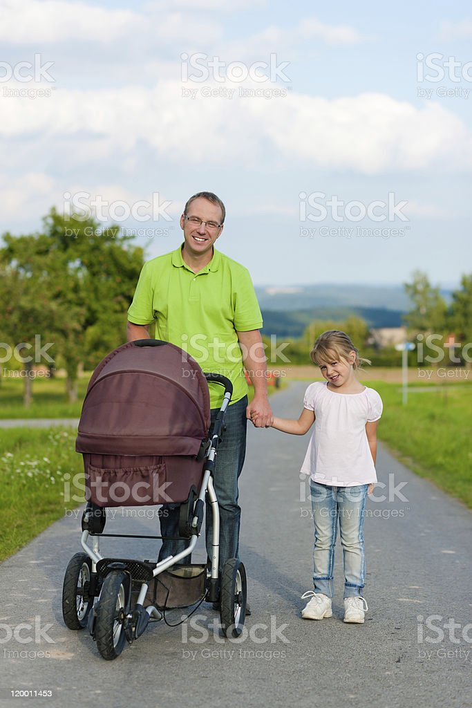 Father with child and baby buggy royalty-free stock photo