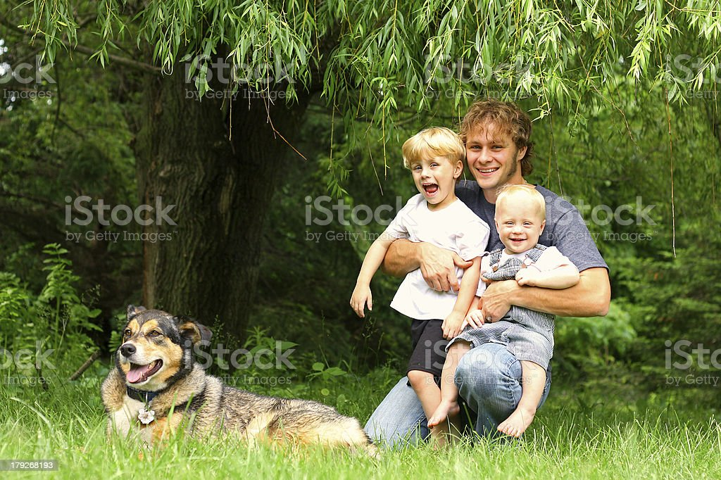 Father with Children and Dog Outside royalty-free stock photo