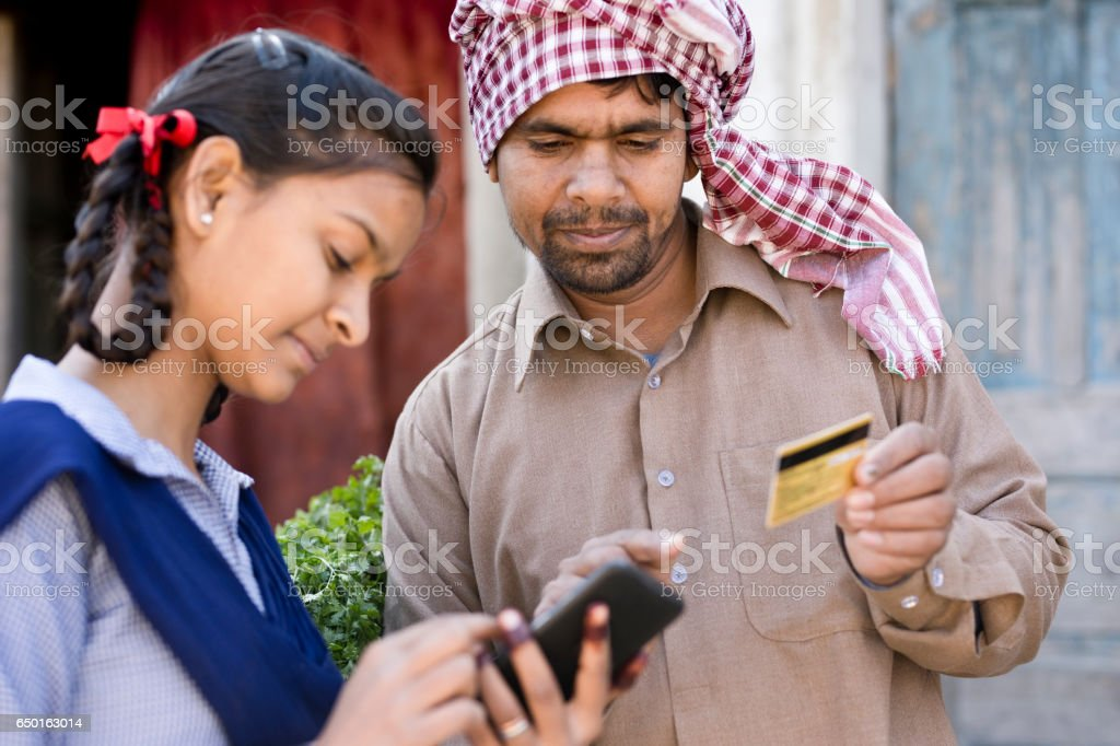 Father with daughter shopping online using credit card stock photo