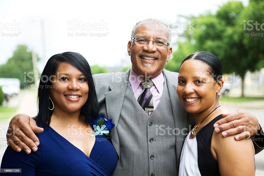 Father with his adult children stock photo