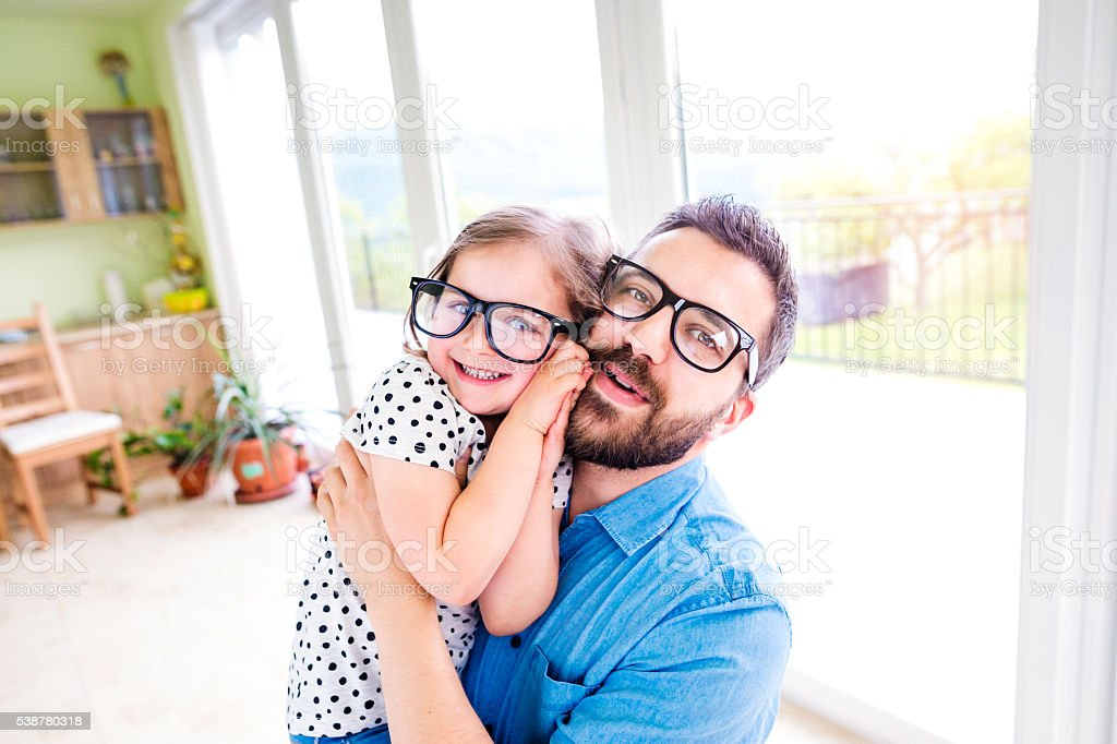 Father with his little daughter in black hipster eyeglasses stock photo