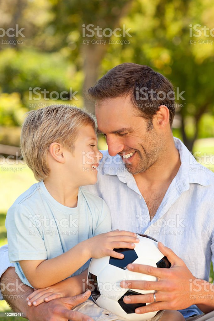Father with his son after a football game royalty-free stock photo