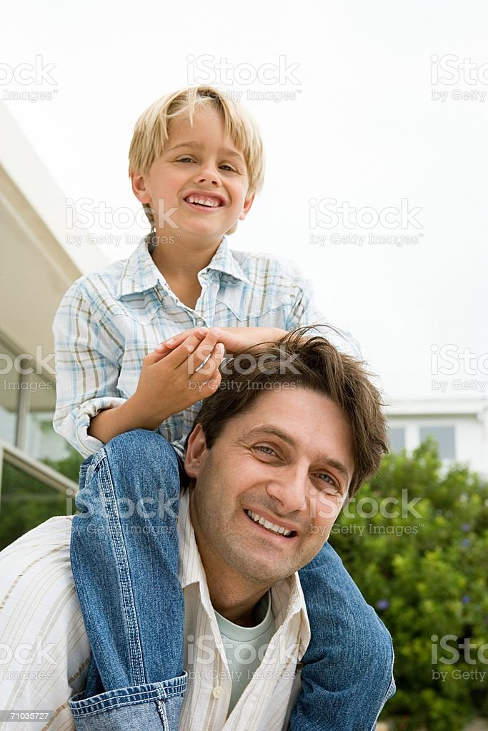Father with his son on his shoulders royalty-free stock photo