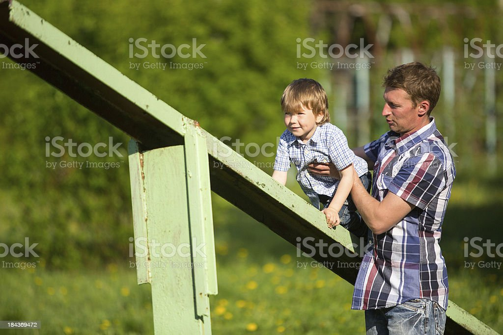Father with his son on the sportsground stock photo