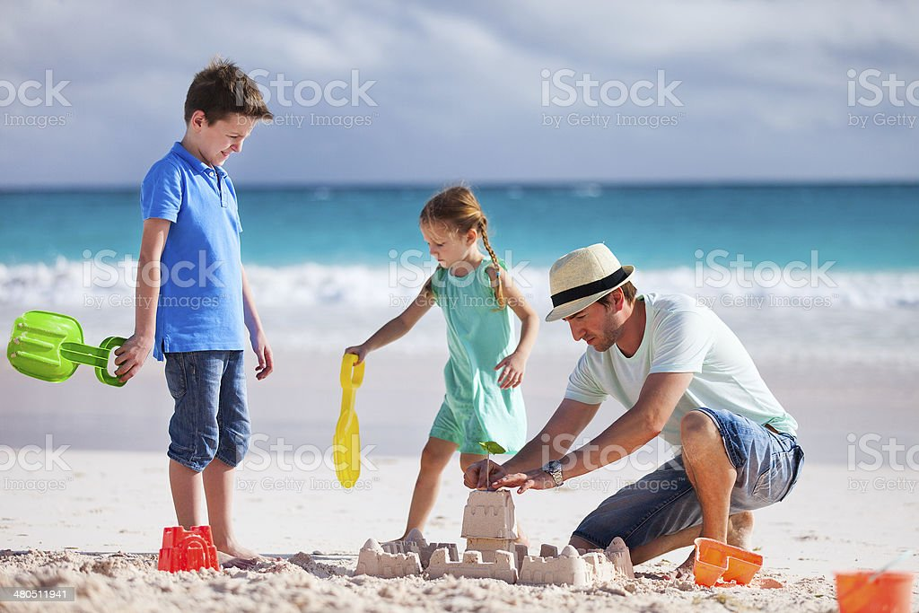 Father with kids at beach royalty-free stock photo