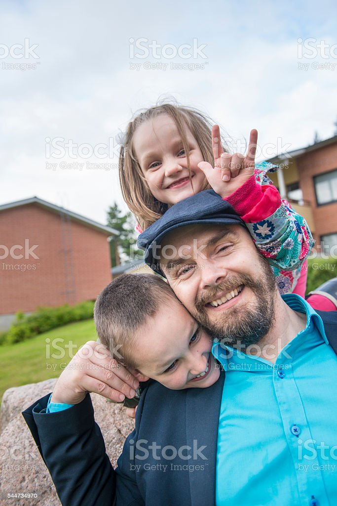 Father with kids outdoors. stock photo