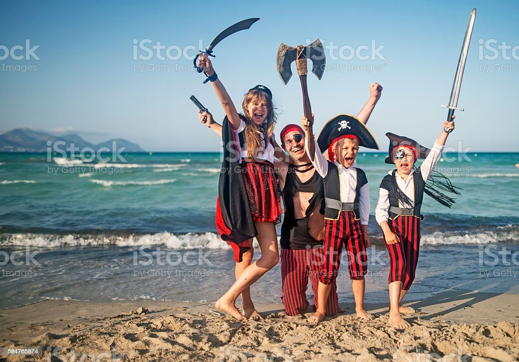 Father with kids playing pirates stock photo