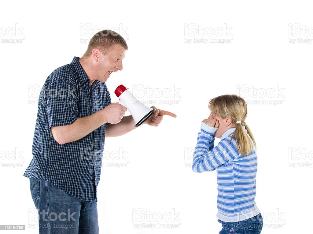 Father with megaphone yelling on his daughter royalty-free stock photo
