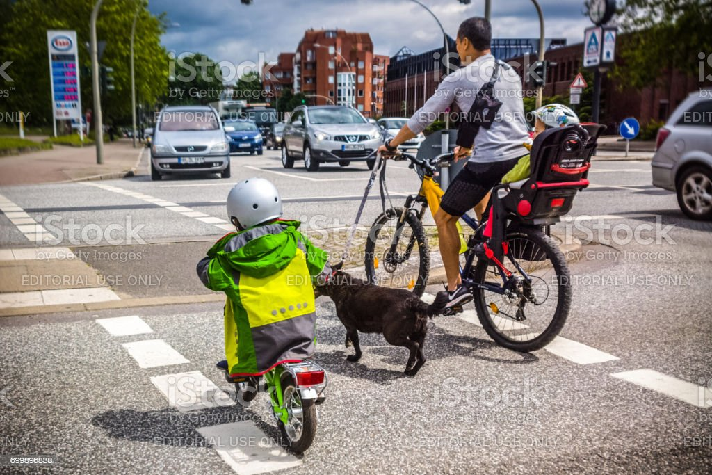 Father with small children on bicycle in the City of Hamburg stock photo