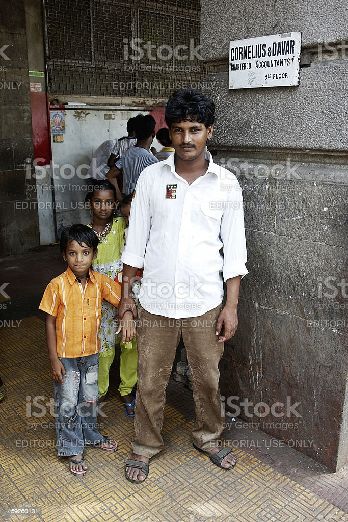 Father with son and daughter on Mumbai street corner royalty-free stock photo