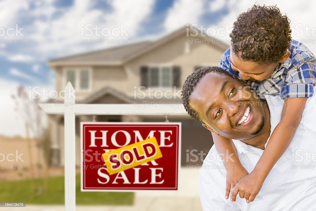 Father with Son In Front of Real Estate Sign, House royalty-free stock photo