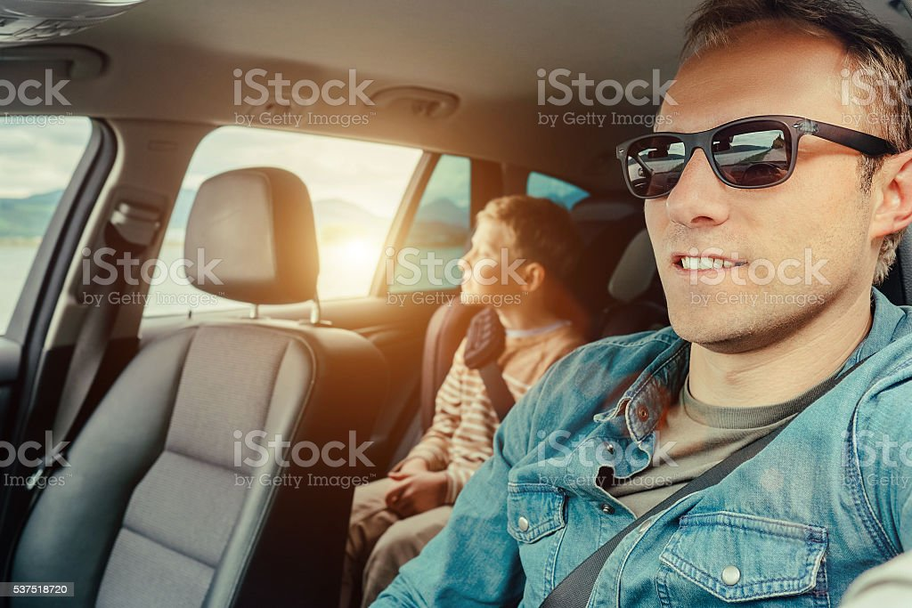 Father with son sit in car stock photo