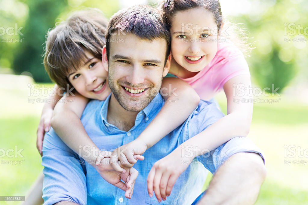 Father with two children stock photo