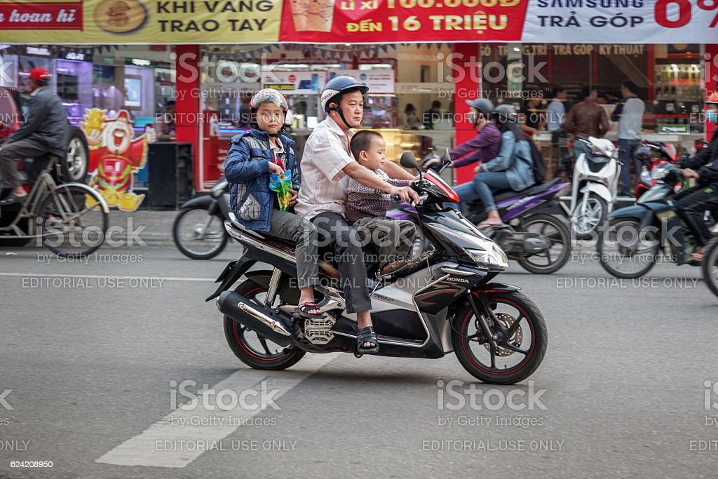 Father with two kids on a motorbike stock photo