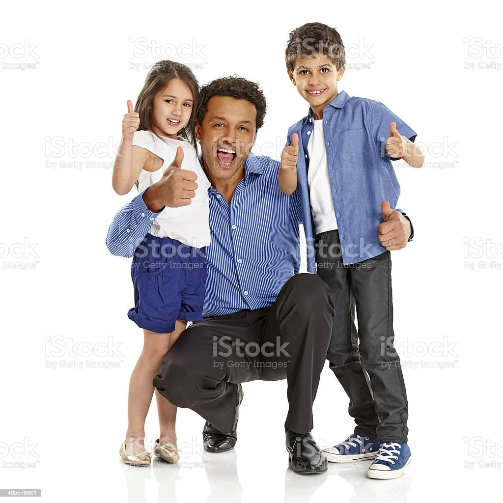 Father with two lovely kids giving thumbs up sign royalty-free stock photo