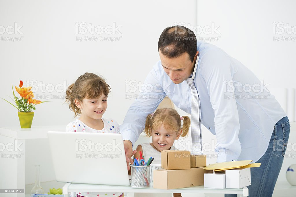 Father Working At Home with Child. royalty-free stock photo