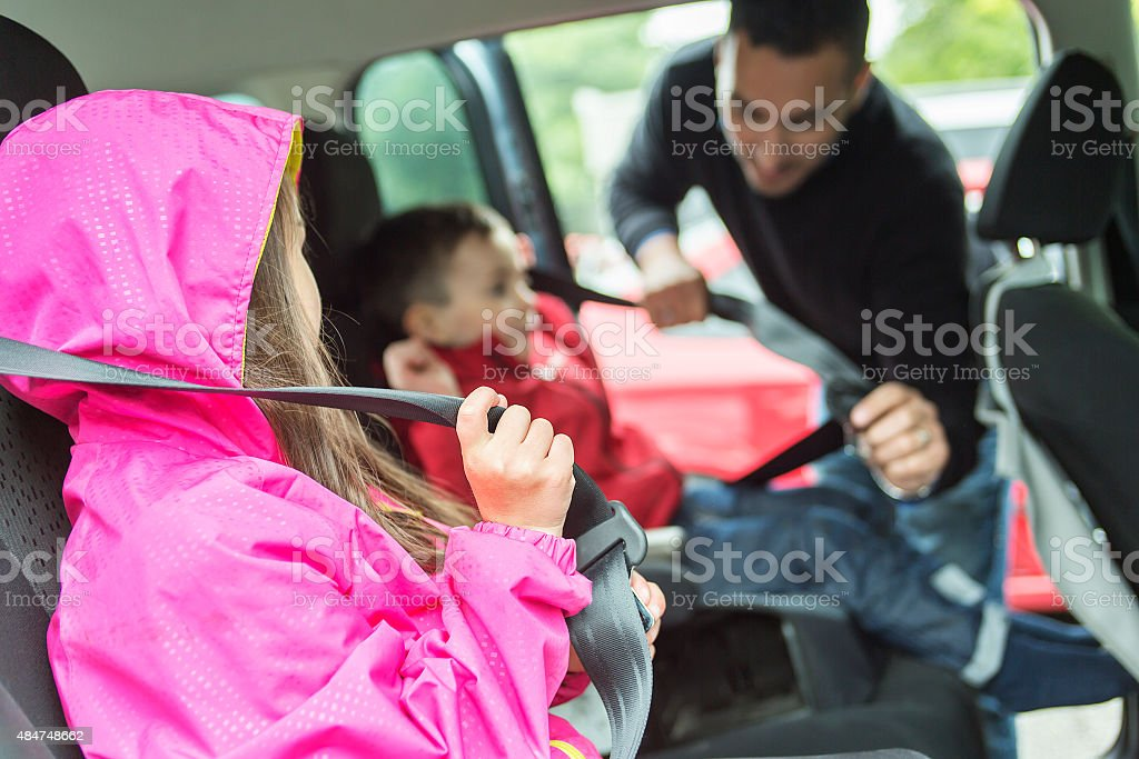 Father worried about her children's safety in a car stock photo