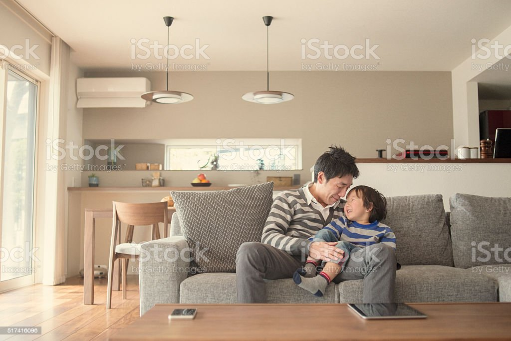 Fatherr and son having fun time at home stock photo