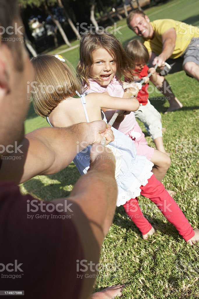 Fathers And Children Playing Tug Of War royalty-free stock photo