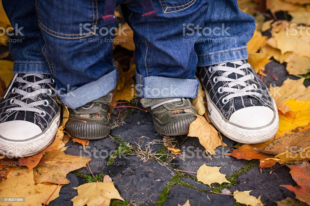 father's and child's shoes together stock photo