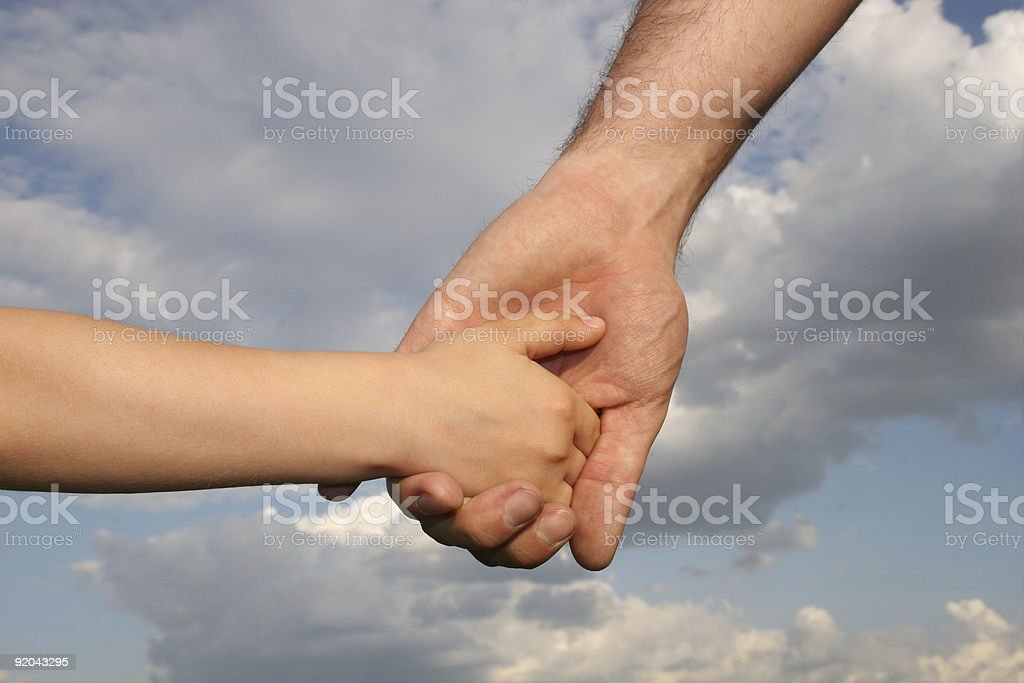 father's and son's hands royalty-free stock photo