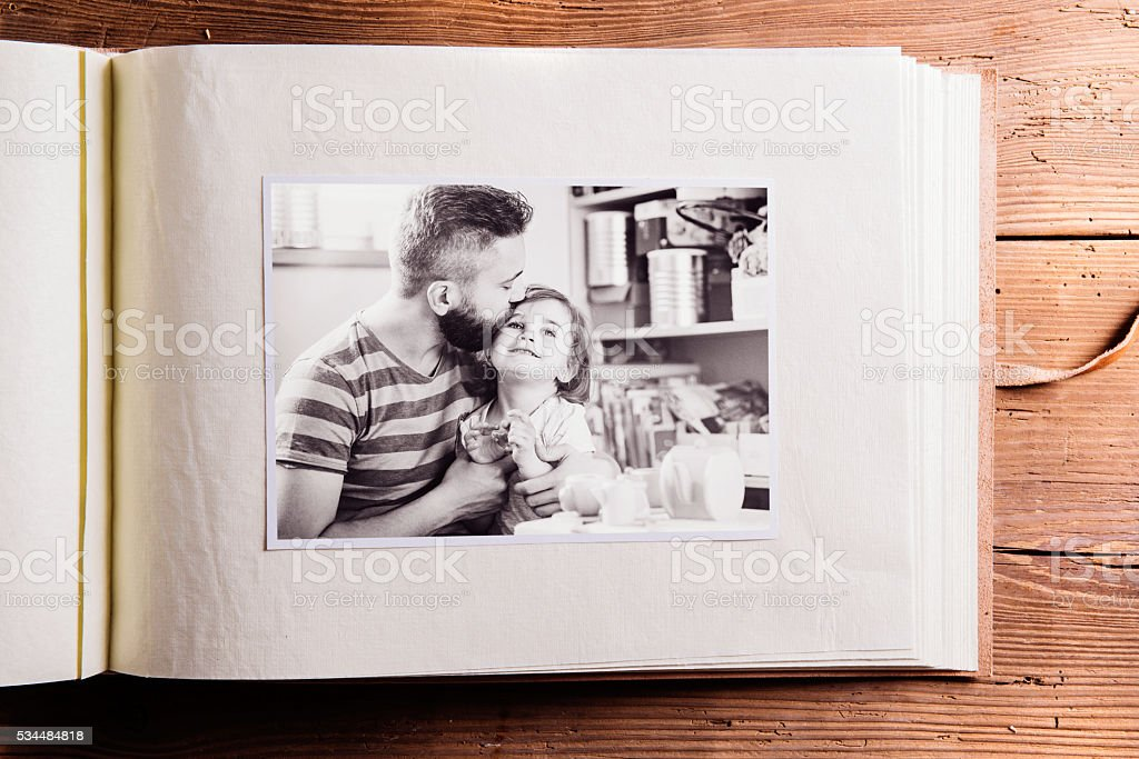 Fathers day composition. Photo album, black-and-white picture. Studio...