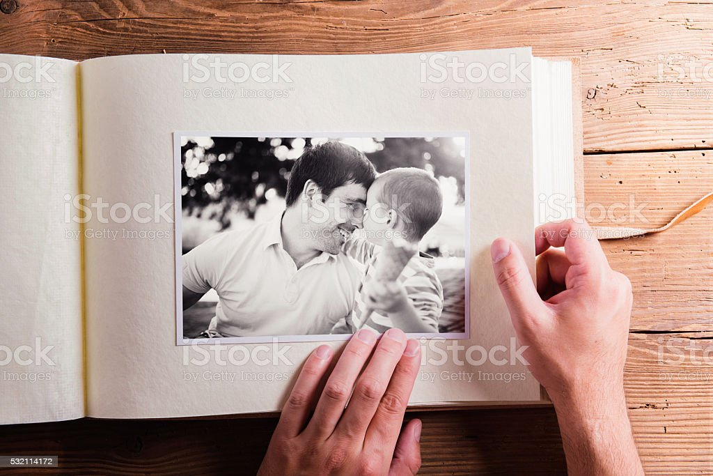 Fathers day composition. Photo album, black-and-white pictures. royalty-free stock photo