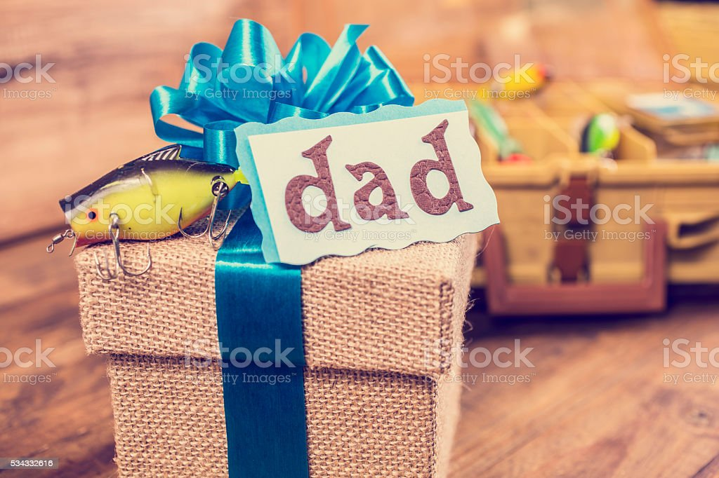 Father's Day fishing gift box for dad.  Lures, tackle box. stock photo