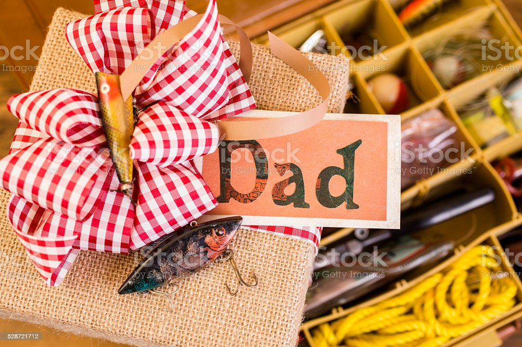 Father's Day, fishing gift for dad. Brown burlap box. Bow. stock photo