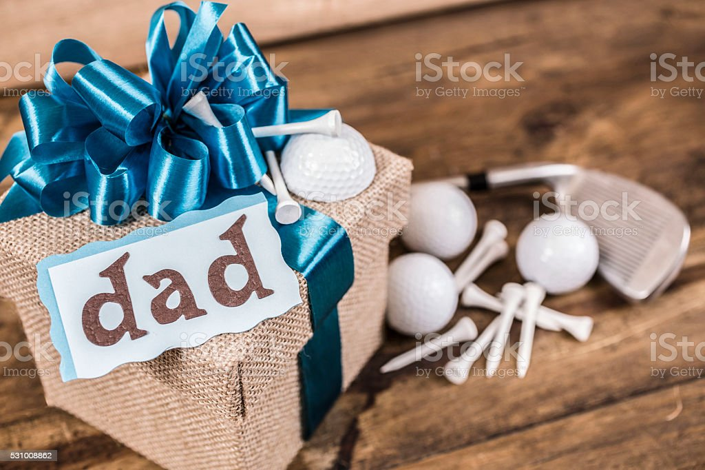 Father's Day!  Golf equipment gift for dad.  Blue bow. stock photo