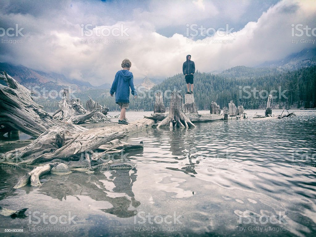 Father's day on a stormy mountain lake stock photo