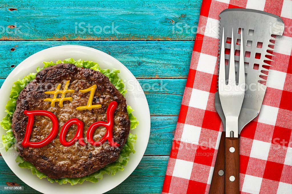 Fathers Day Picnic with BBQ Utensils stock photo