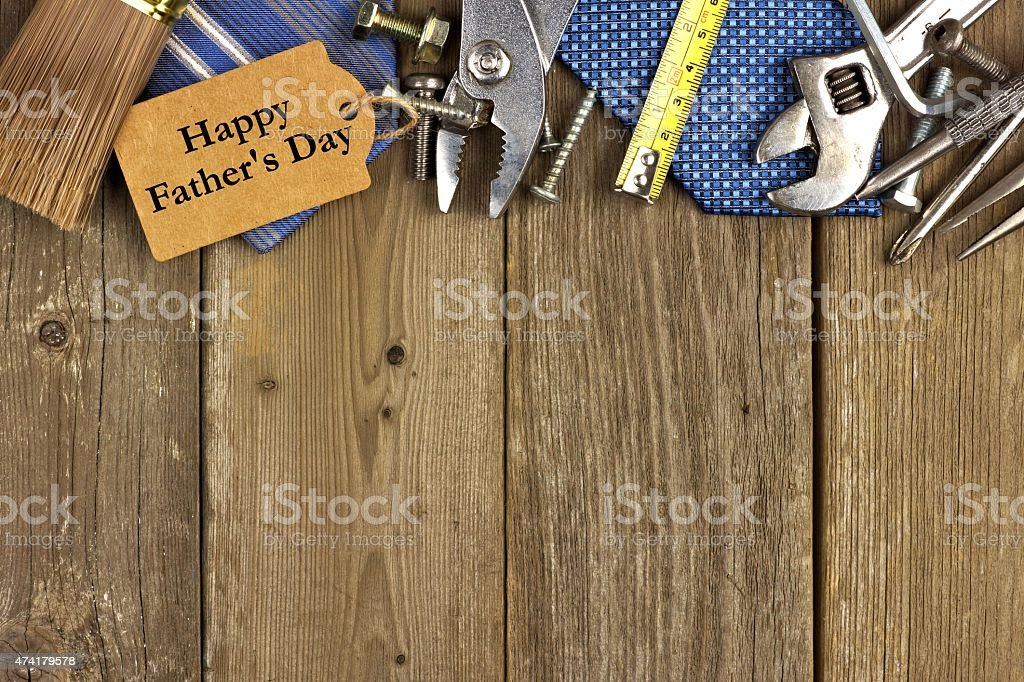 Fathers Day tag with tools and ties border on wood stock photo