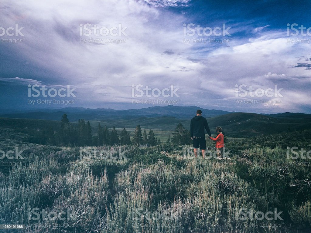 Father's love in Summer in beautiful mountains stock photo