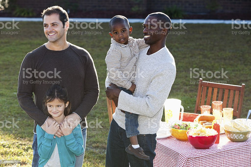 Fathers with children at picnic stock photo