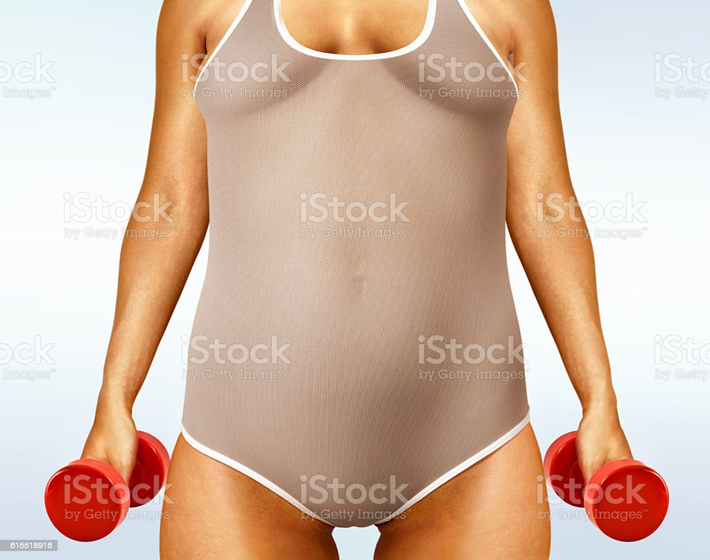 fatty woman with dumbbells stock photo