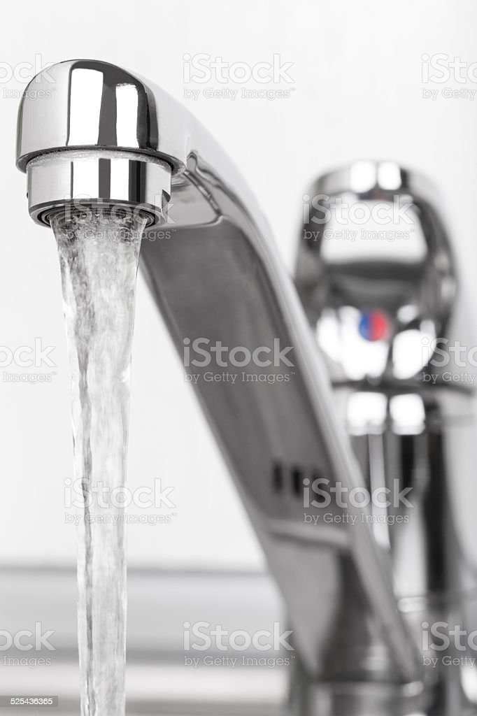 Faucet and water drop stock photo